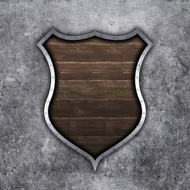 3d old metal and wood shield on grunge concrete background Free Photo