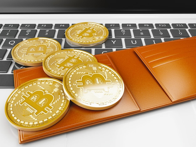 3d pile of bitcoin gold coins on a computer keyboard Photo | Premium