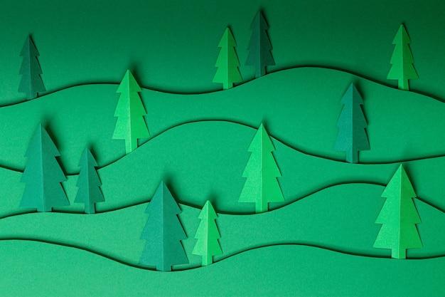 3d выдвижные рождественские елки из бумаги на зеленом Premium Фотографии