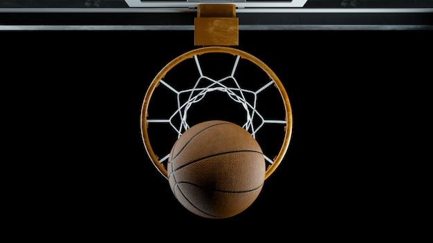 3d визуализации баскетбол попал в корзину на черном фоне Premium Фотографии