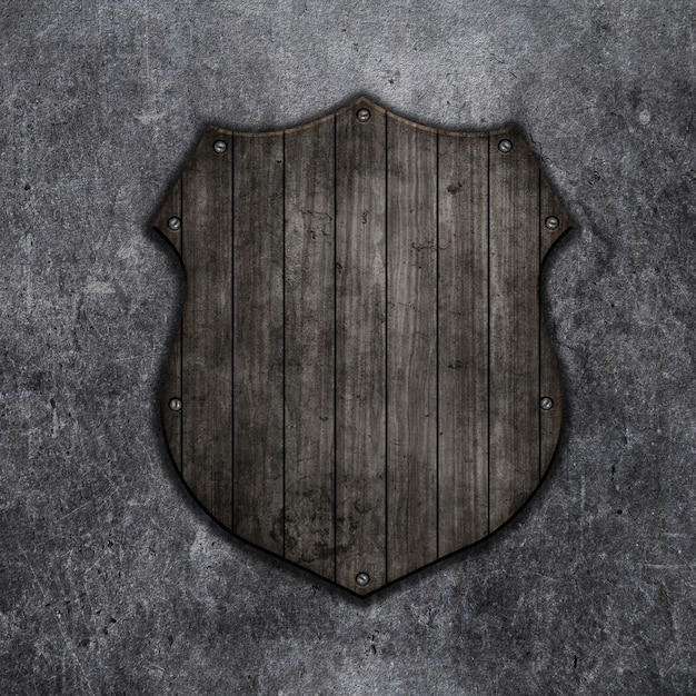 3d render of a wooden shield on a grunge background Free Photo