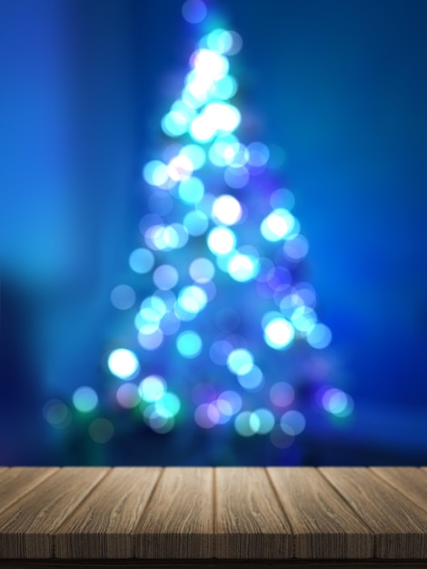 3d render of wooden table looking out to a defocussed christmas tree Premium Photo