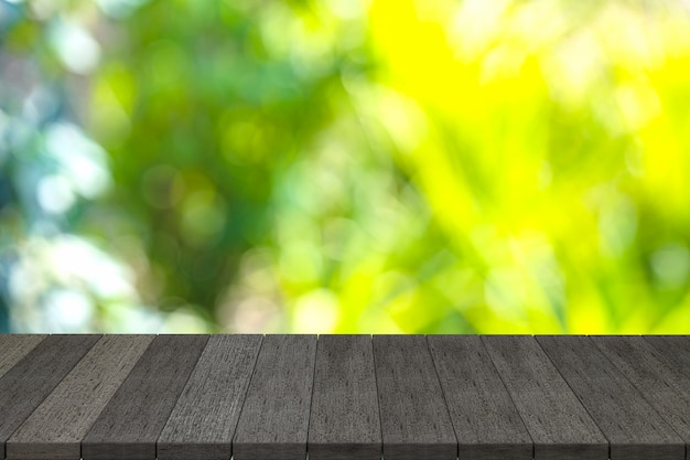 3d rendering, black wooden shelves or black wood table with view nature backdrop.you can used for display products. or add your own text on space Premium Photo