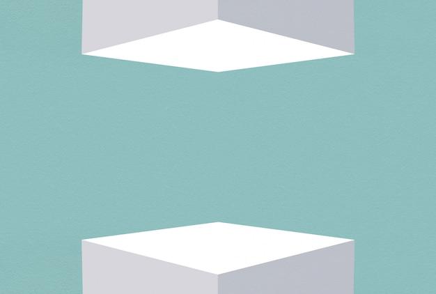 3d 렌더링. 블루 사파이어 시멘트 벽 디자인 배경 가진 위아래로 흰색 큐브 상자를 비 웁니다. 프리미엄 사진