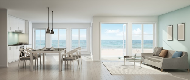 3d rendering of sea view living room, dining room and kitchen in beach house. Premium Photo