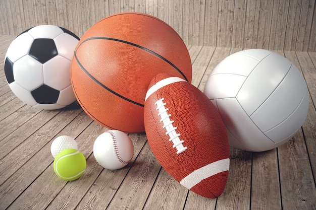 3d rendering sport balls on wooden backgorund Premium Photo