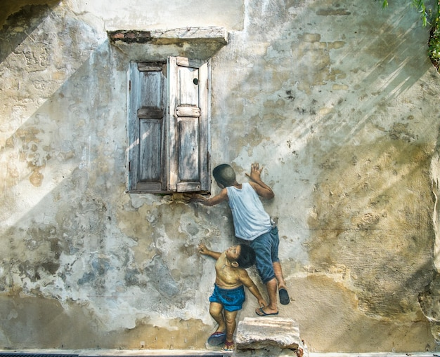 3d Street Art On The Wall Painting Of Boys Are Playing Near The