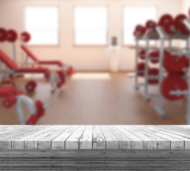 3d white wooden table looking out to a defocussed gym interior Photo