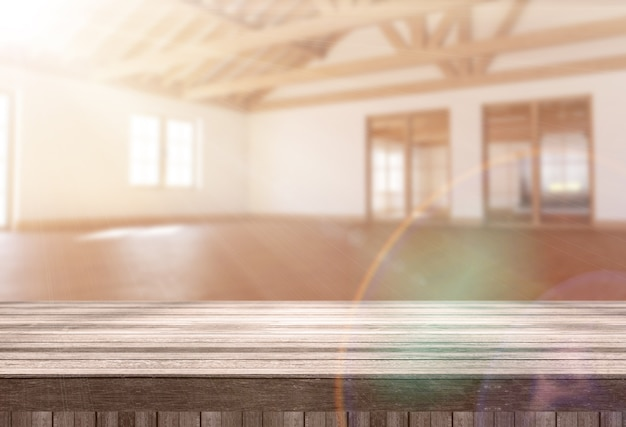 3d wooden table looking out to a modern empty room with sun shining through the window Free Photo
