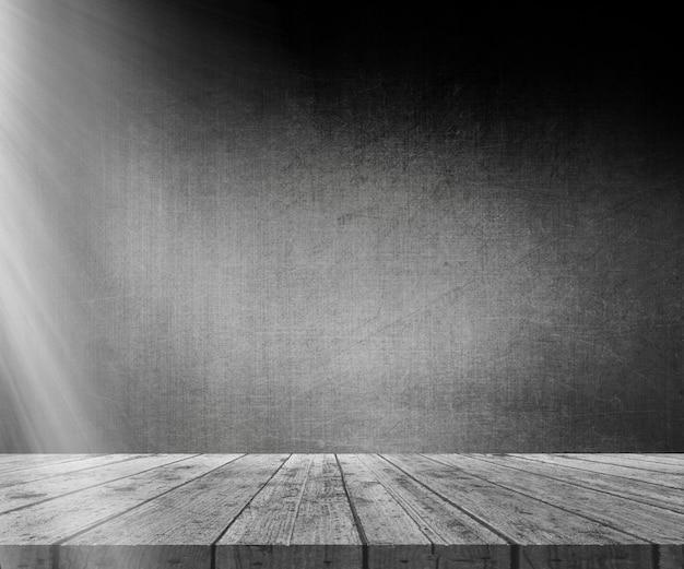 3d деревянный стол против гранж стены со светом, сияющим слева Бесплатные Фотографии