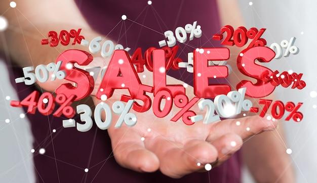 Бизнесмен держа значки продаж в его переводе руки 3d Premium Фотографии