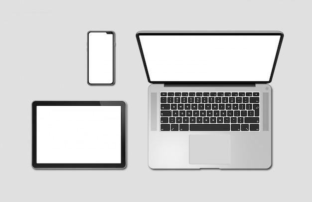 ラップトップ、タブレット、電話は灰色に分離されたモックアップを設定します。 3dレンダリング Premium写真