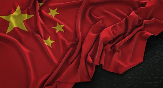 暗い背景にレンダリングされた中国の国旗3dレンダリング 無料写真