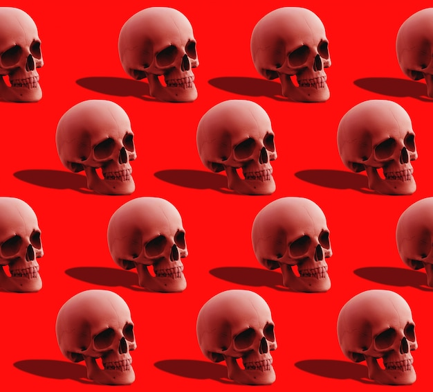 3d-рендеринг. безшовная красная картина кости черепа человеческой головы на красном цвете. Premium Фотографии