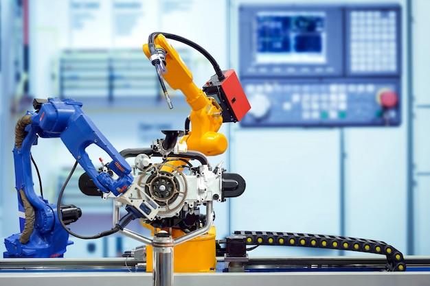 産業用ロボット溶接およびスマート工場のエンジン部品を使用したロボット3dスキャン。 Premium写真