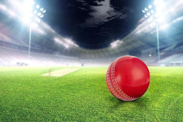 Крикет стадион с мячом в огнях и вспышки 3d визуализации Premium Фотографии