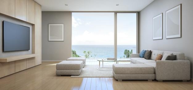 3d рендеринг вид на море гостиная с террасой в современном роскошном домике на пляже. Premium Фотографии
