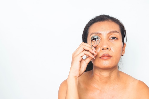 40-49 years asian woman with makeup routine. beauty and health. surgery Premium Photo