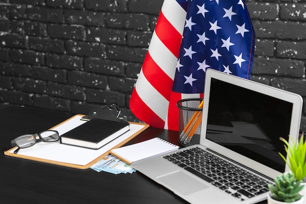 4th of july american independence day usa flags decorations in office desk with computer Premium Photo