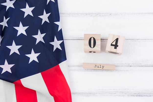 4th of july on wooden calendar Free Photo