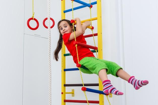 7 years old child playing on sports equipment Premium Photo