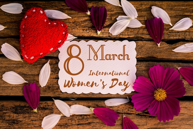 8 march happy international women's day message on wooden background. Premium Photo