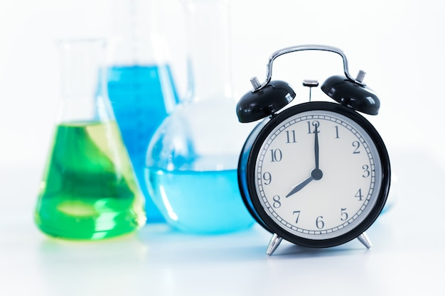 8 o'clock retro clock with science chemical medical research lab background Premium Photo