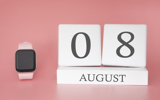 Современные часы с кубическим календарем и датой 8 августа на розовой стене. концепция летнего отдыха. Premium Фотографии
