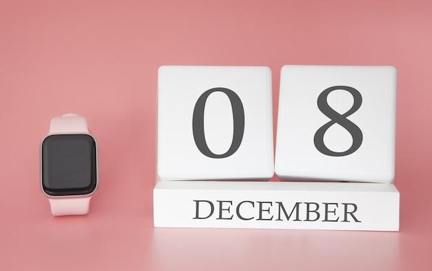 Современные часы с календарем куб и датой 8 декабря на розовом фоне. концепция зимнего отдыха. Premium Фотографии