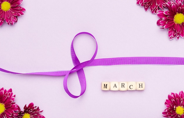 8th of march ribbon symbol and flowers Free Photo