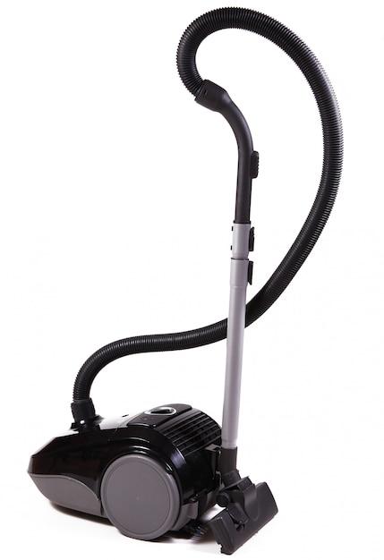 白い背景の上の家のための掃除機 Premium写真