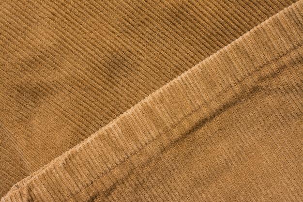 ベルベットのパンツの質感、コットン生地。ポケットとリベット。繊維の背景 Premium写真
