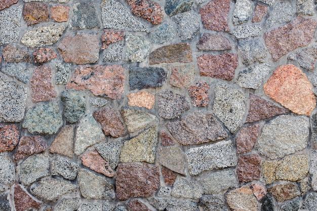 石の壁の背景のパターン。 Premium写真