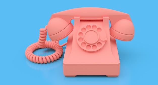 青い表面に古いピンクのダイヤル電話 Premium写真