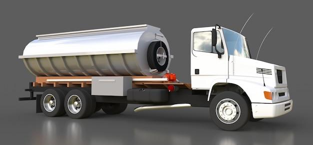 磨かれた金属のトレーラーが付いている大きい白いトラックのタンカー Premium写真