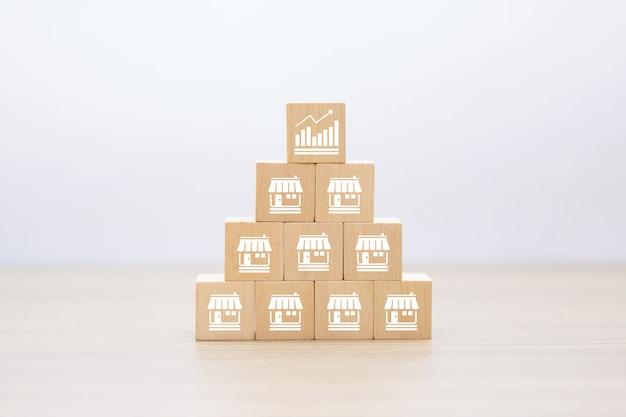 積み上げ木製ブロックのフランチャイズビジネスアイコン Premium写真