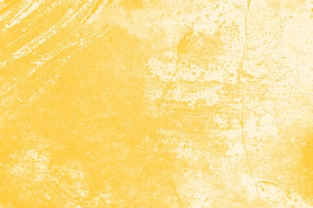 黄色の苦しめられた壁のテクスチャ背景 無料写真