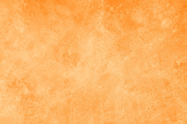 抽象的な明るいオレンジ色または黄色の壁のテクスチャ 無料写真