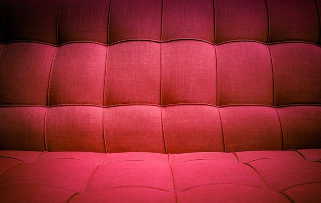 赤い布のソファの質感。 Premium写真