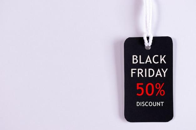 テキスト付きのブラックフライデータグ Premium写真