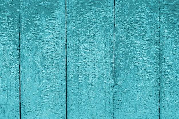 青い塗られた古い木製アクアマリンの壁の背景。 Premium写真