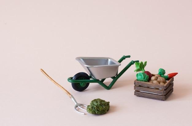野菜の箱が付いている農場または園芸工具の現実的な図 Premium写真