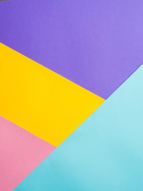 カラフルな色紙の背景。 Premium写真