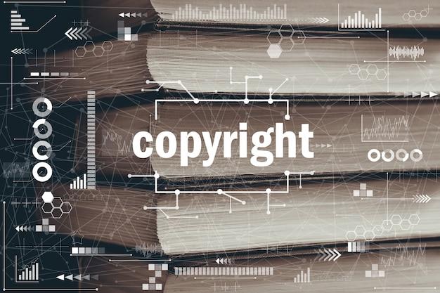 Абстрактная концепция авторского права графика на фоне книг. Premium Фотографии