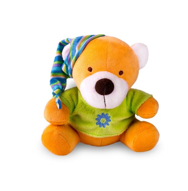 分離されたキャップのおもちゃのクマ Premium写真