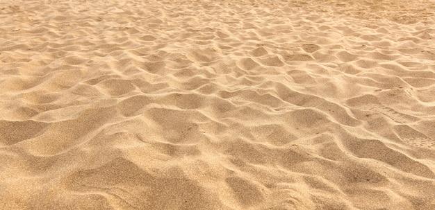 Песок на пляже в качестве фона Premium Фотографии