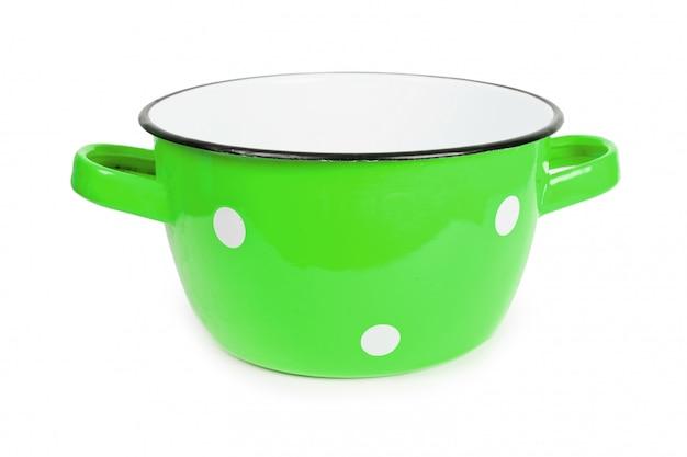 分離された白い斑点ヴィンテージと緑鍋 Premium写真