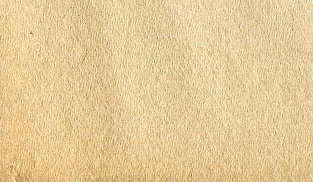 背景テクスチャ紙黄色の色合い Premium写真
