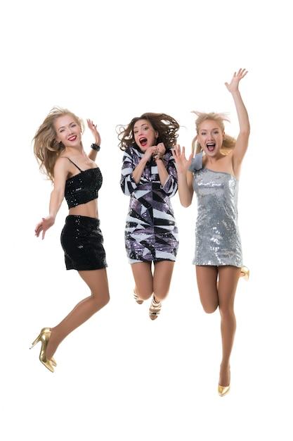 美しい幸せな女の子がスタジオでジャンプしています Premium写真