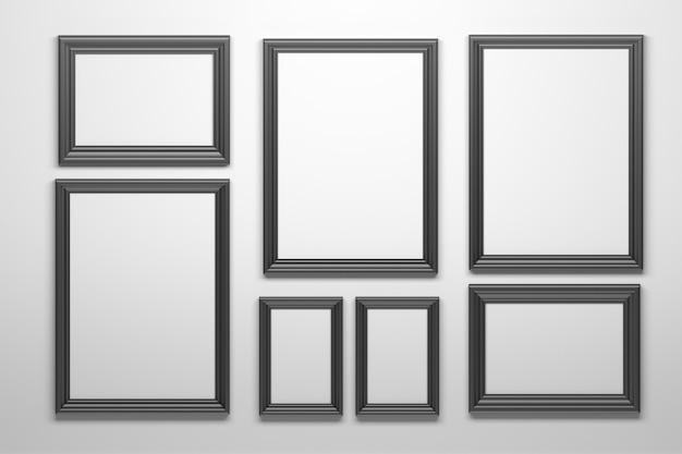 Комплект рамок много различных форм черных на белой стене. Premium Фотографии